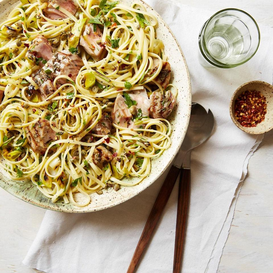 """In addition to the tuna, the leeks and garlic are also grilled, giving this simple Mediterranean-inspired pasta sauce complex flavor. <a href=""""https://www.epicurious.com/recipes/food/views/linguine-with-grilled-tuna-capers-and-parsley-51241210?mbid=synd_yahoo_rss"""" rel=""""nofollow noopener"""" target=""""_blank"""" data-ylk=""""slk:See recipe."""" class=""""link rapid-noclick-resp"""">See recipe.</a>"""