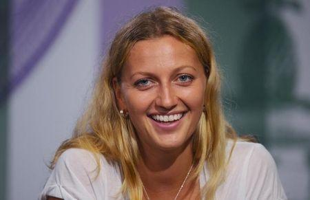 Petra Kvitova of the Czech Republic attends a news conference after defeating Eugenie Bouchard of Canada in their women's singles final tennis match at the Wimbledon Tennis Championships, in London July 5, 2014. REUTERS/Javier Garcia/AELTC/Pool
