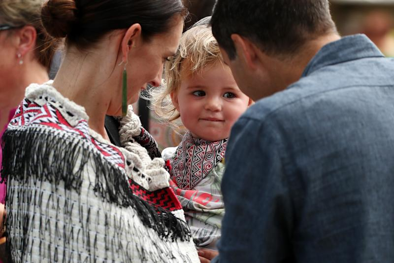 New Zealand Prime Minister and her partner Clarke Gayford with their daughter Neve Gayford at the upper Treaty grounds at Waitangi on February 04, 2020 in Waitangi, New Zealand.