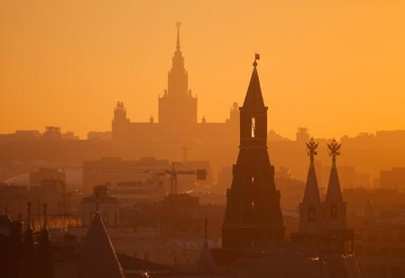 View shows building of Moscow State University and tower of Kremlin in Moscow