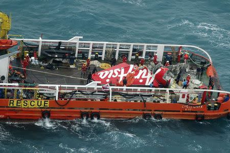 The tail of AirAsia QZ8501 passenger plane is seen on the deck of the Indonesian Search and Rescue (BASARNAS) ship Crest Onyx after it was lifted from the sea bed, south of Pangkalan Bun, Central Kalimantan January 10, 2015. REUTERS/Suharso/Pool