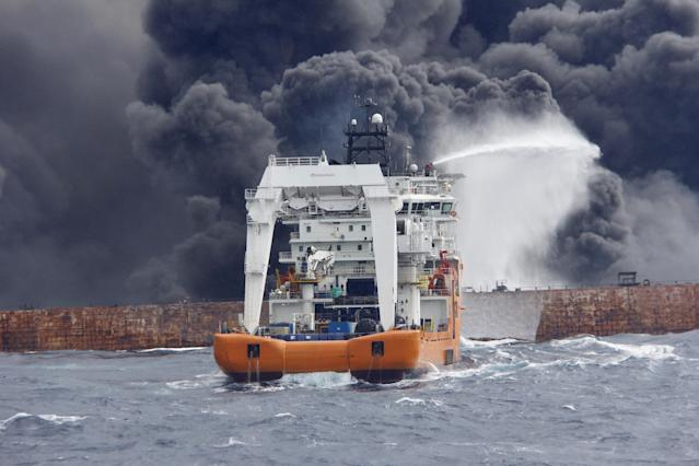 <p>A rescue ship works to extinguish the fire on the burning Iranian oil tanker Sanchi in the East China Sea, in this Jan. 12, 2018 picture provided by Shanghai Maritime Search and Rescue Centre and released by China Daily. (Photo: China Daily via Reuters) </p>