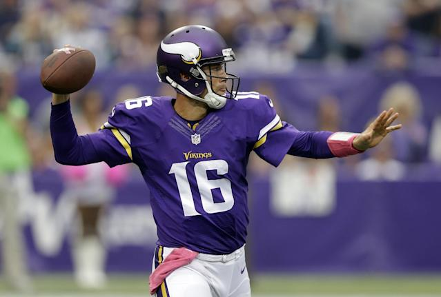 Minnesota Vikings quarterback Matt Cassel throws against the Carolina Panthers during the first half of an NFL football game in Minneapolis, Sunday, Oct. 13, 2013. (AP Photo/Michael Conroy)