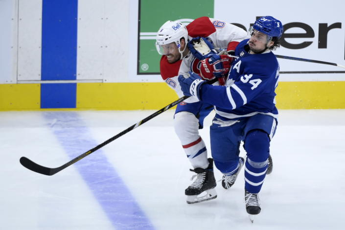 Montreal Canadiens defenseman Shea Weber (6) ties up Toronto Maple Leafs forward Auston Matthews (34) during the third period of a first round NHL Stanley Cup hockey game in Toronto, Monday, May 31, 2021. (Nathan Denette/The Canadian Press via AP)