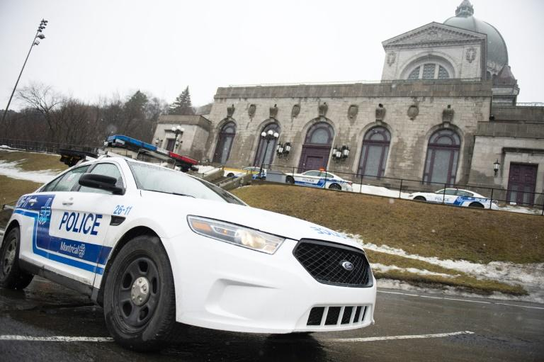 Police provide security at Saint Joseph's Oratory in Montreal on March 22, 2019, after priest Claude Grou was stabbed