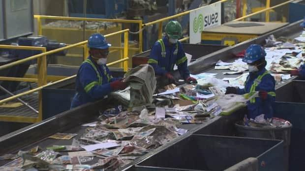 The recycling facility at the Edmonton Waste Management Centre processes paper, newspaper, boxes, tin cans, glass jars and bottles, and plastic containers and bags.