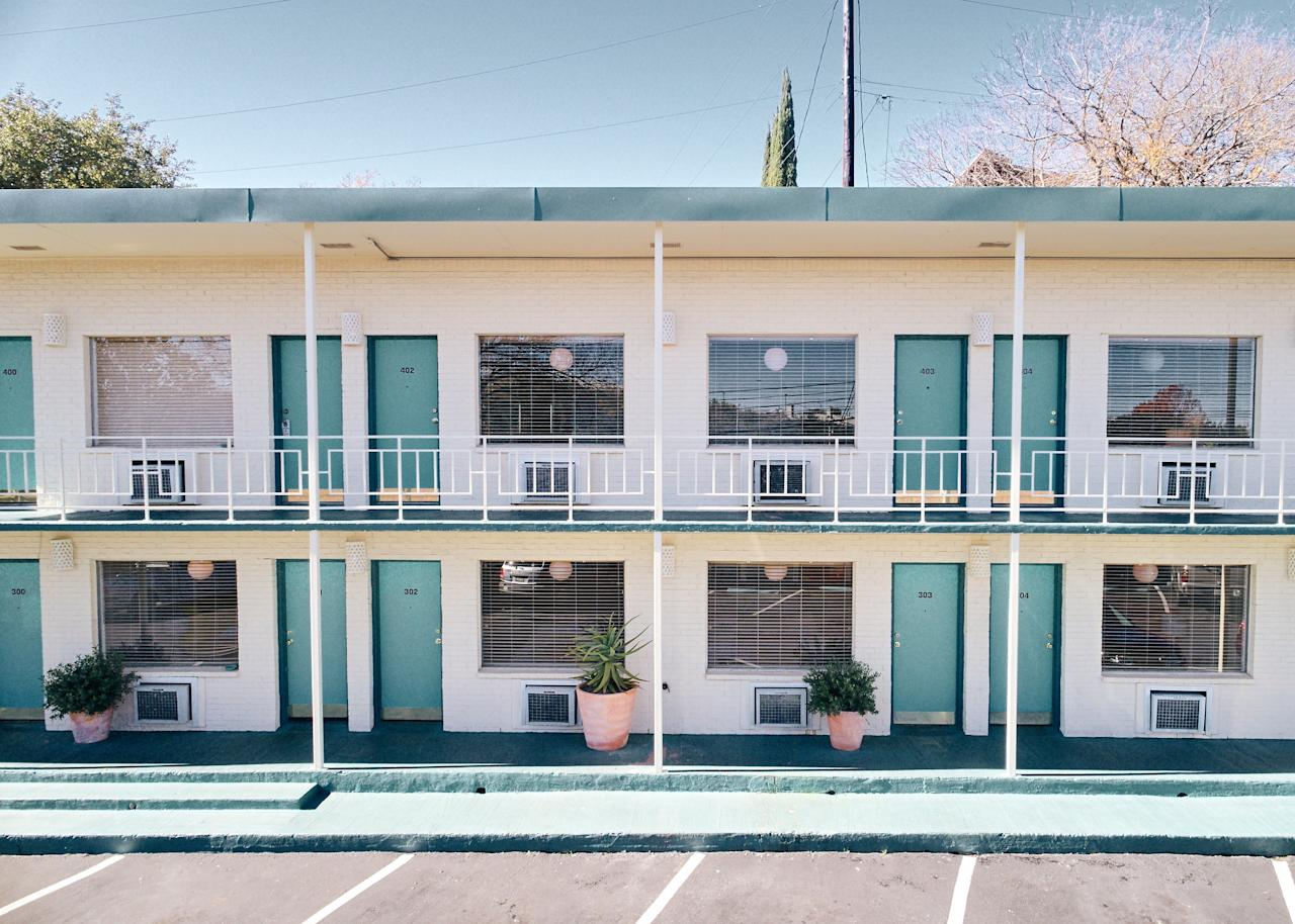 "<p><strong>How did it strike you on arrival?</strong><br> ""Motel"" isn't a misnomer: In 2017, famously-hip hotelier Liz Lambert transformed the 1930s-era white stucco Austin Motel into a retro motor inn. As you park your car outside your hotel room door, take note of the iconic (phallic) red neon sign.</p> <p><strong>What's the crowd like?</strong><br> Most guests are here to take advantage of SoCo's live music and nightlife.</p> <p><strong>The good stuff: Tell us about the rooms.</strong><br> Rooms have been updated but are original to the hotel (apparently they didn't need closets in the '30s). The decor is funky and playful: red, tufted-vinyl platforms, custom Voutsa wallpaper in a pattern of lips, old-school push-button phones.</p> <p><strong>We're craving some deep, restorative sleep. They got us?</strong><br> Custom Sferra sheets will make the beds feel like home to many.</p> <p><strong>How about the little things, like mini bar, or shower goodies. Any of that worth a mention?</strong><br> Pick up snacks and beer or wine at the Bodega; there's no mini bar (nor turn-down services).</p> <p><strong>Please tell us the bathroom won't let us down.</strong><br> The small bathrooms have Alaffia Everyday Coconut products in the shower. But shucks, they're bolted to the wall so you can't steal them.</p> <p><strong>Maybe the most important topic of all: Wi-Fi. What's the word?</strong><br> Wi-Fi is free and fast.</p> <p><strong>What do they have for food?</strong><br> There's no room service, but the gift shop sells protein bars, candy, local beers, and a small selection of wine that oeneophiles would approve of.</p> <p><strong>Anything stand out about other services and features?</strong><br> On warm days, the massive kidney-shaped pool is filled with guests, almost all with a cocktail or Austin Motel koozie in-hand. Pets are also welcome (for an added fee)</p> <p><strong>What was most memorable about your stay?</strong><br> Peacefully sitting in the red Barcelona chairs in the courtyard.</p> <p><strong>Bottom line: worth it, and why?</strong><br> Its proximity to bustling South Congress is ideal for some travelers, but this is a true motel (not hotel) experience.</p>"