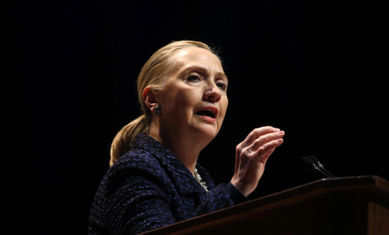 """Secretary of State Hillary Rodham Clinton gestures as she gives a speech: """"Frontlines and Frontiers: Making Human Rights a Human Reality,"""" Thursday, Dec. 6, 2012, at Dublin City University in Dublin, Ireland. (AP Photo/Kevin Lamarque, Pool)"""