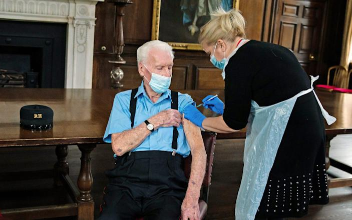 D-Day veteran Robert Sullivan, 98, is injected with the Pfizer/BioNTech Covid-19 vaccine by Chief Nurse Pippa Nightingale - Getty Images Europe