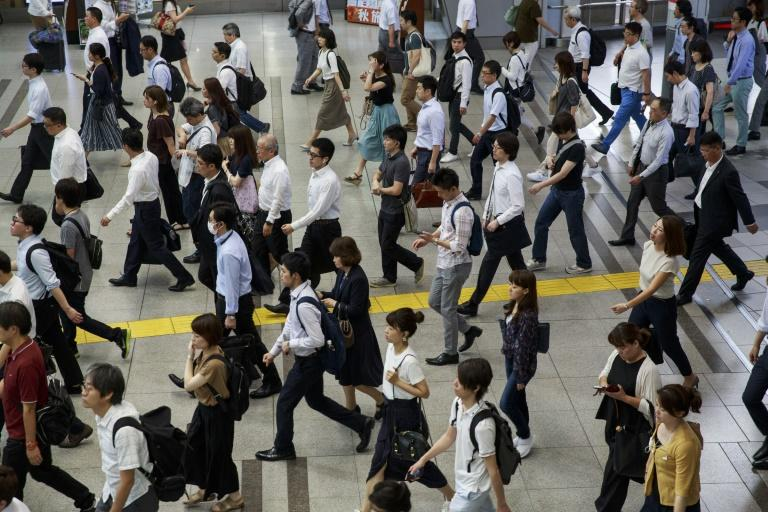 Japanese employees spend more hours at the office than workers in almost any other nation. (AFP Photo/Behrouz MEHRI)