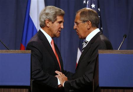 U.S. Secretary of State John Kerry (L) and Russian Foreign Minister Sergei Lavrov (R) shake hands after making statements following meetings regarding Syria, at a news conference in Geneva September 14, 2013. REUTERS/Larry Downing
