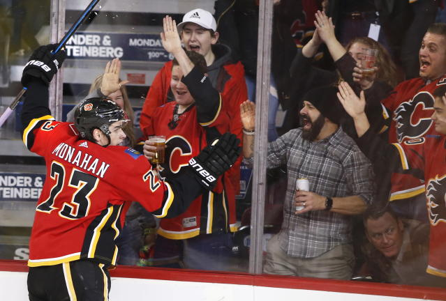 Calgary Flames' Sean Monahan celebrates his goal with fans during the second period of an NHL hockey game against the Los Angeles Kings on Saturday, Dec. 7, 2019, in Calgary, Alberta. (Larry MacDougal/The Canadian Press via AP)