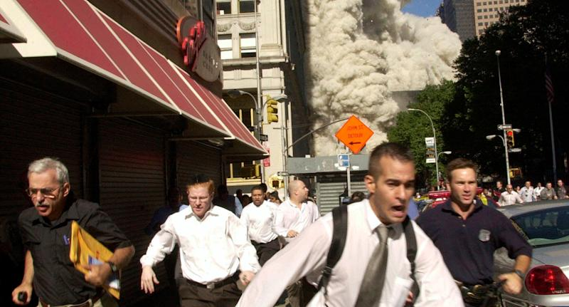 Stephen Cooper, the man in a famous photo fleeing 9/11, has died from coronavirus.