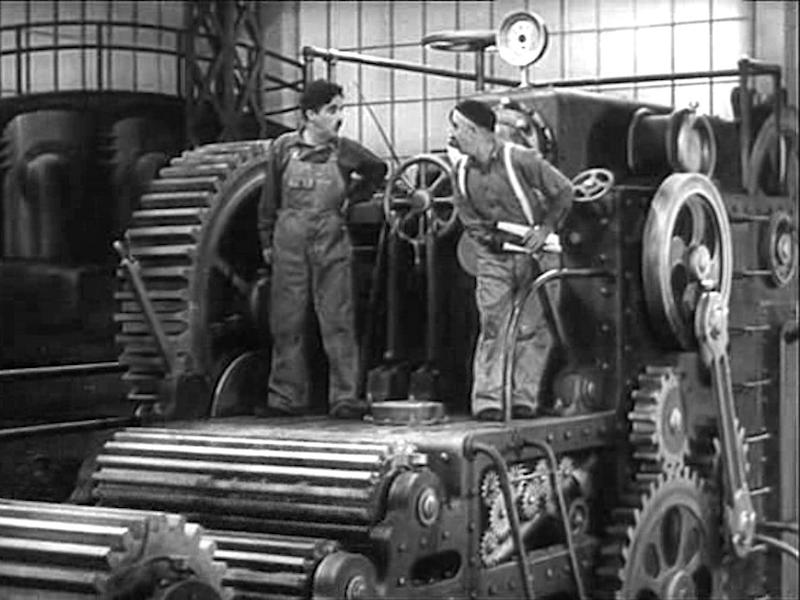 charlie chaplin machine cogs old fashioned black and white silent movie