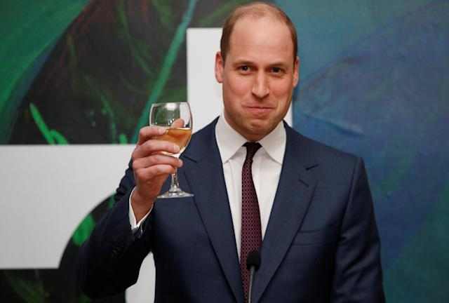 Prince William raises his glass as he and his wife Catherine attend the reception. (Reuters)