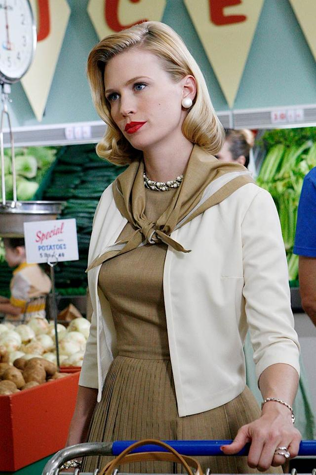"""<b>Betty Draper, """"Mad Men""""</b>  <b>Signature Style:</b> Retro charm. January Jones, the actress who has played Betty Draper (now Francis) since 2007, has said that putting on her character's early 1960's garments is a key part of her process. """"I get into the girdle, the bra with the pointy cups, the stockings, the heels, the big dress...and I'm halfway there.""""  <b>Why We Love Her:</b> Betty's retro full-skirted ensembles have had a profound effect on current fashion, which is perhaps part of the reason January has said she hopes the action doesn't continue into the 1980's. """"I don't want to see Betty in Spandex.""""   <a href=""""http://www.instyle.com/instyle/package/transformations/photos/0,,20290121_20401717_20810716,00.html?xid=omg-janaury-jones-trans?yahoo=yes"""" target=""""new"""">January Jones' Transformation</a> Carin Baer/AMC"""