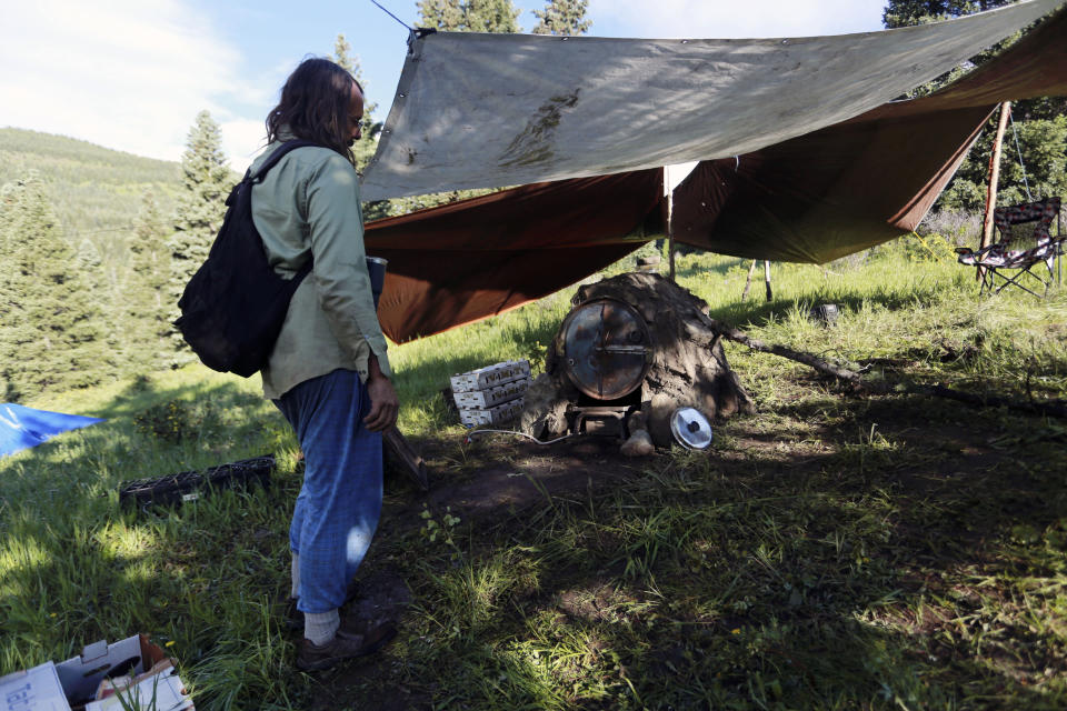 Darrell Schauermann, of Taos, shows off a propane-powered oven he got hauled into the remote Rainbow Gathering, as seen Friday, July 2, 2021, in the Carson National Forest, outside of Taos, N.M. More than 2,000 people have made the trek into the mountains of northern New Mexico as part of an annual counterculture gathering of the so-called Rainbow Family. While past congregations on national forest lands elsewhere have drawn as many as 20,000 people, this year's festival appears to be more reserved. Members (AP Photo/Cedar Attanasio)