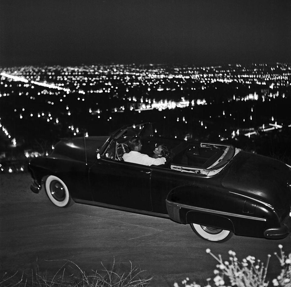 <p>We can't think of anything more romantic than checking out the Los Angeles skyline in a retro car back in 1951. </p>