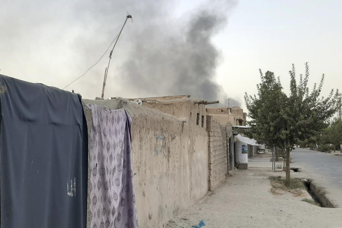 Smoke rises from the city of Lashkar Gah after airstrikes against Taliban in Helmand province southern of Kabul, Afghanistan, Friday, Aug. 6, 2021. The Afghan air force carried out more airstrikes against Taliban positions in southern Afghanistan on Thursday, as the insurgent force made additional gains in the country's north. (AP Photo/Abdul Khaliq)