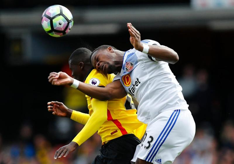 Watford's M'Baye Niang in action with Lamine Koné.