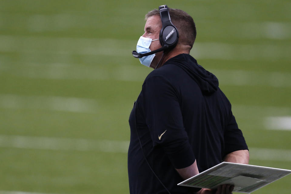 New Orleans Saints head coach Sean Payton wears a mask as a precaution against the coronavirus, in the first half of an NFL football game against the Los Angeles Chargers in New Orleans, Monday, Oct. 12, 2020. (AP Photo/Brett Duke)