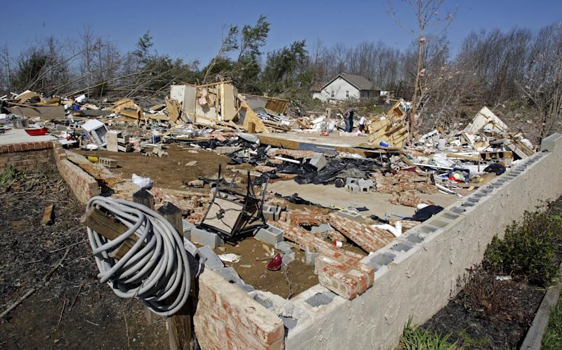 The foundation is all that remains of the home where Carolyn Jones was killed by a deadly tornado in the Rinnie Community near Crossville, Tenn. Thursday, March 1, 2012. A pre-dawn twister flattened entire blocks of homes Wednesday as violent storms ravaged the Midwest and South. (AP Photo/Wade Payne)