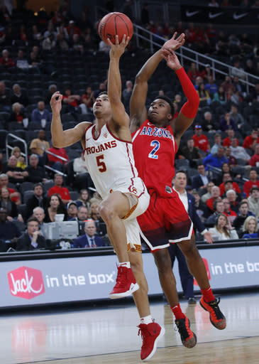 Southern California's Derryck Thornton (5) shoots ahead Arizona's Brandon Williams during the first half of an NCAA college basketball game in the first round of the Pac-12 conference tournament Wednesday, March 13, 2019, in Las Vegas. (AP Photo/John Locher)
