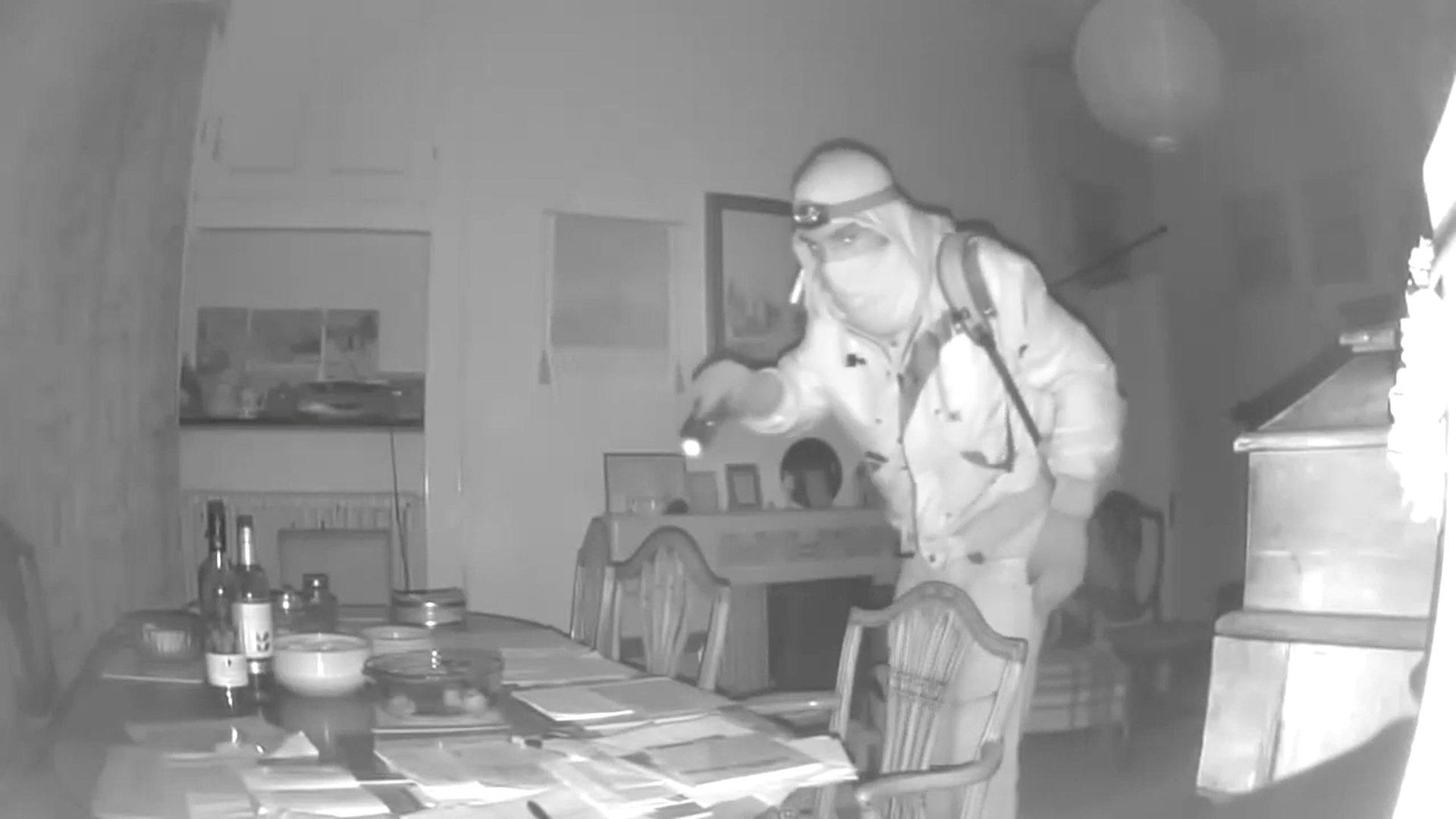 The thief pictured searching the man's home in the dead of night. (SWNS)