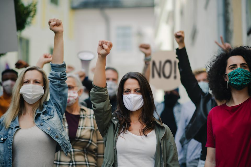 Portrait of group of people activists protesting on streets, women march and demonstration concept.