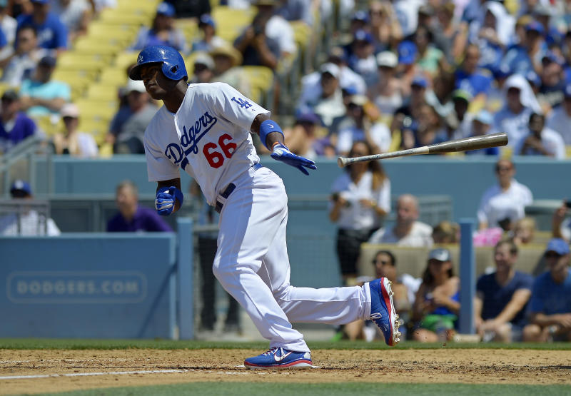 Los Angeles Dodgers' Yasiel Puig hits a single during the fifth inning of a baseball game against the Colorado Rockies, Sunday, July 14, 2013, in Los Angeles. (AP Photo/Mark J. Terrill)