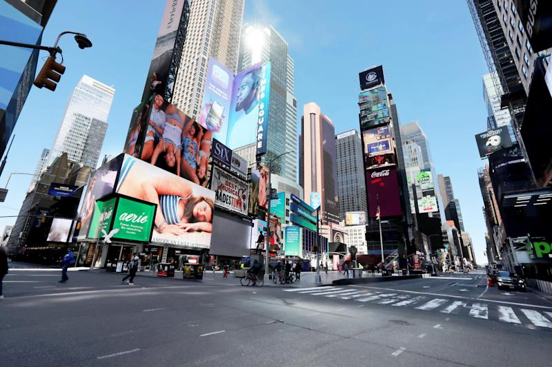 Times Square in Manhattan was far emptier than usual for a Saturday afternoon March 21, 2020. Coronavirus concerns have closed almost all businesses and kept most New Yorkers indoors.