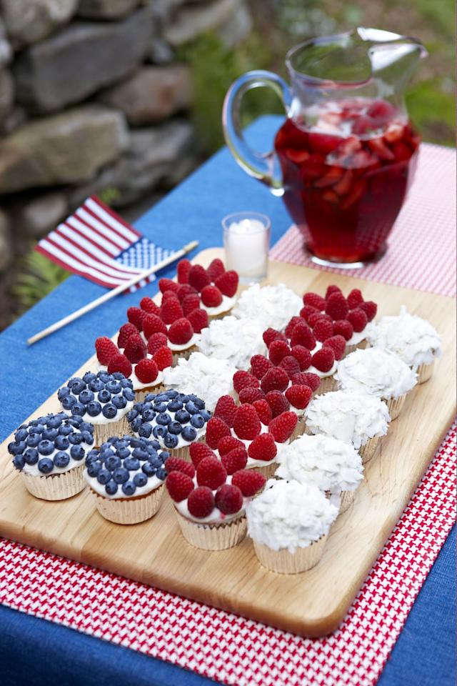"<p>Forgo the typical flag cake and opt for this easy-to-pull-off, portable version instead.<em></em></p><p><em></em><a rel=""nofollow"" href=""https://www.goodhousekeeping.com/food-recipes/a10121/cupcake-flag-berries-coconut-ghk0710/""><em>Get the recipe for Cupcake Flag with Berries and Coconut »</em></a></p>"