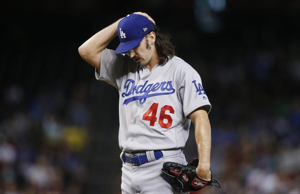 Los Angeles Dodgers starting pitcher Tony Gonsolin pauses on the mound during the first inning of a baseball game against the Arizona Diamondbacks Wednesday, June 26, 2019, in Phoenix. (AP Photo/Ross D. Franklin)