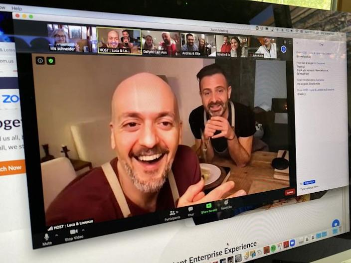 Cooking via Zoom. February 14, 2021. Italian chefs Luca Brozzi, left, and Lorenzo Manfrini talk to their students while teaching a ravioli-making class via Zoom from their home near Florence, Italy.
