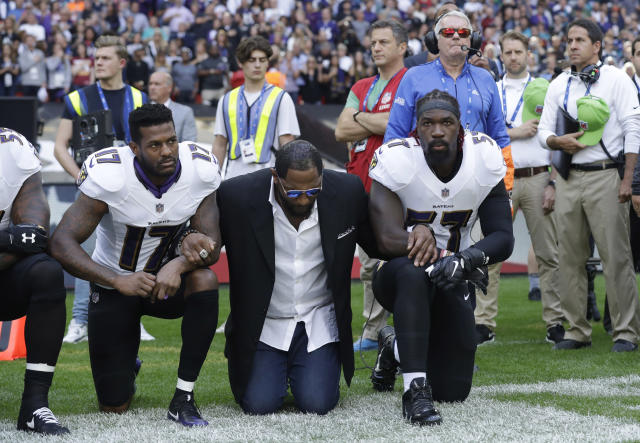 <p>Baltimore Ravens wide receiver Mike Wallace, from left, former player Ray Lewis and inside linebacker C.J. Mosley lock arms and kneel down during the playing of the U.S. national anthem before an NFL football game against the Jacksonville Jaguars at Wembley Stadium in London, Sunday Sept. 24, 2017. (AP Photo/Matt Dunham) </p>
