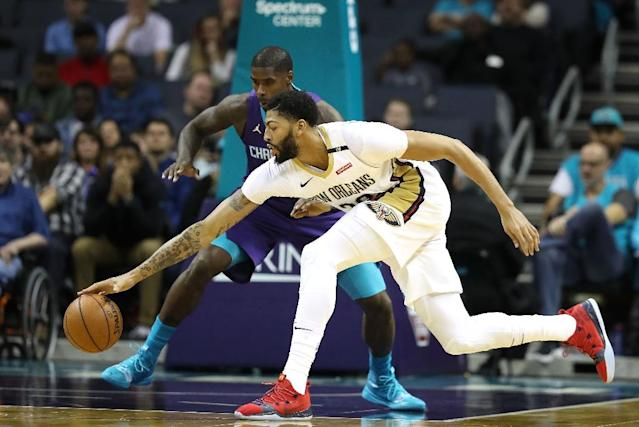 New Orleans' Anthony Davis goes after a loose ball on the way to a 36-point performance in the Pelicans' win over the Charlotte Hornets (AFP Photo/STREETER LECKA)