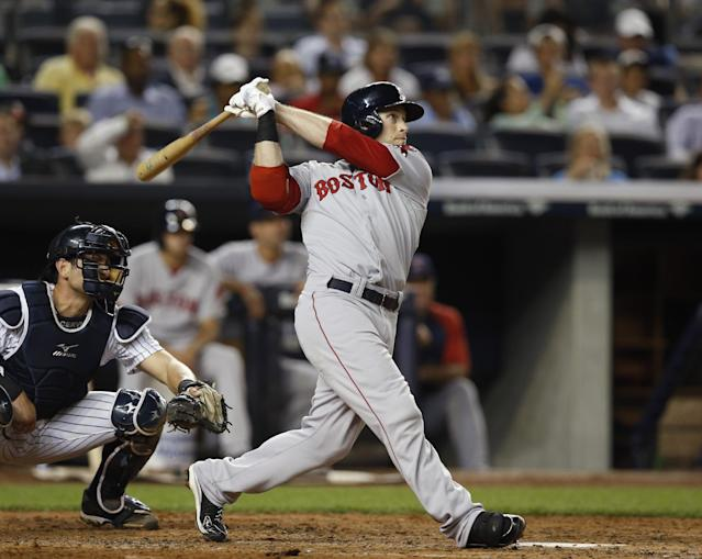 Boston Red Sox's Daniel Nava hits a third-inning three-run home run off New York Yankees starting pitcher Shane Greene in a baseball game at Yankee Stadium in New York, Tuesday, Sept. 2, 2014. (AP Photo/Kathy Willens)