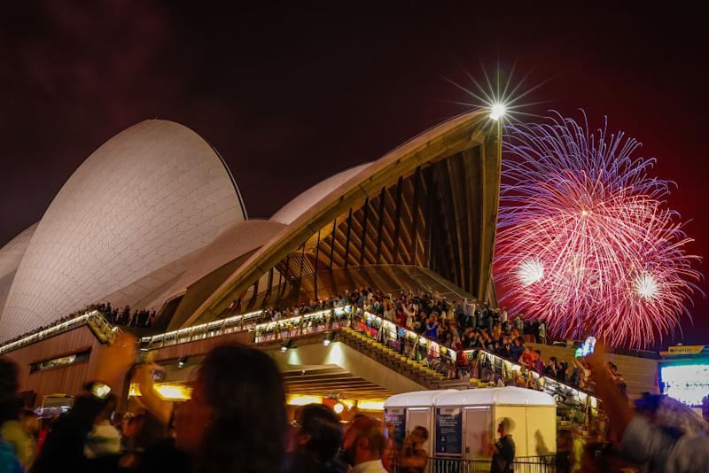 Fireworks explode over the Sydney Harbour Bridge and Sydney Opera House during the midnight display during New Year's Eve celebrations on January 01, 2020 in Sydney, Australia. | Hanna Lassen—Getty Images