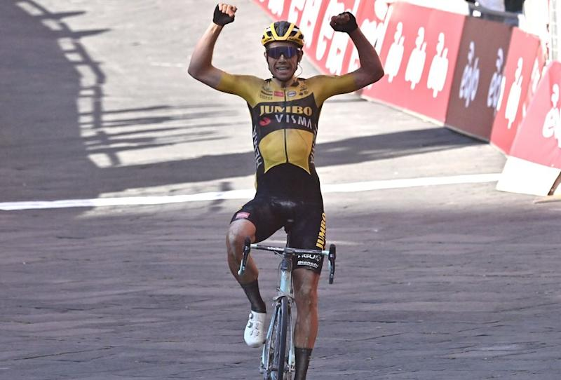 Team JumboVisma Belgian rider Wout van Aert celebrates as he crosses the finish line to win the oneday classic cycling race Strade Bianche White Roads on August 1 2020 in Siena Tuscany Photo by Marco BERTORELLO AFP Photo by MARCO BERTORELLOAFP via Getty Images