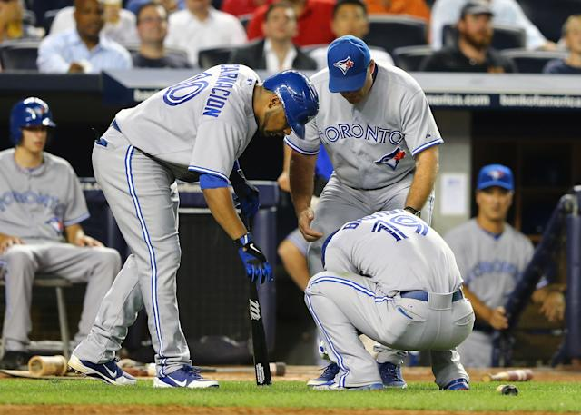 NEW YORK, NY - JULY 16: Jose Bautista #19 of the Toronto Blue Jays is in pain after hurting his wrist swinging the bat during their game against the New York Yankees on July 16, 2012 at Yankee Stadium in the Bronx borough of New York City. (Photo by Al Bello/Getty Images)