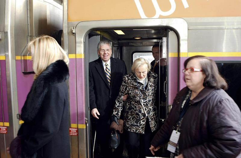 FILE - In this Dec. 6, 2010 file photo, Rhode Island Gov. Donald Carcieri and his wife Sue arrive at the new commuter rail station at T.F. Green Airport in Warwick, R.I., aboard a ceremonial MBTA train to inaugurate service to Boston. More passengers are using the commuter rail line between Providence and Rhode Island's main airport, transportation officials reported Friday, April 6, 2012, but not as many as was hoped when the trains started rolling in late 2010.  The MBTA said ridership statistics 14 months after the service began show an average of 149 people take the train to the airport each weekday, and 177 people ride outbound. (AP Photo/Joe Giblin, File)