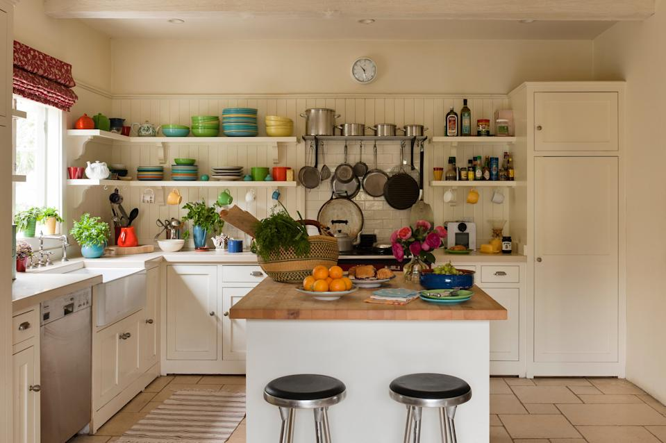 "<h1 class=""title"">Santa Monica home of textile and interior designer Kathryn Ireland</h1> <div class=""caption""> Barstools and a butcher's island in a white kitchen with colorful crockery </div> <cite class=""credit"">Andreas von Einsiedel</cite>"