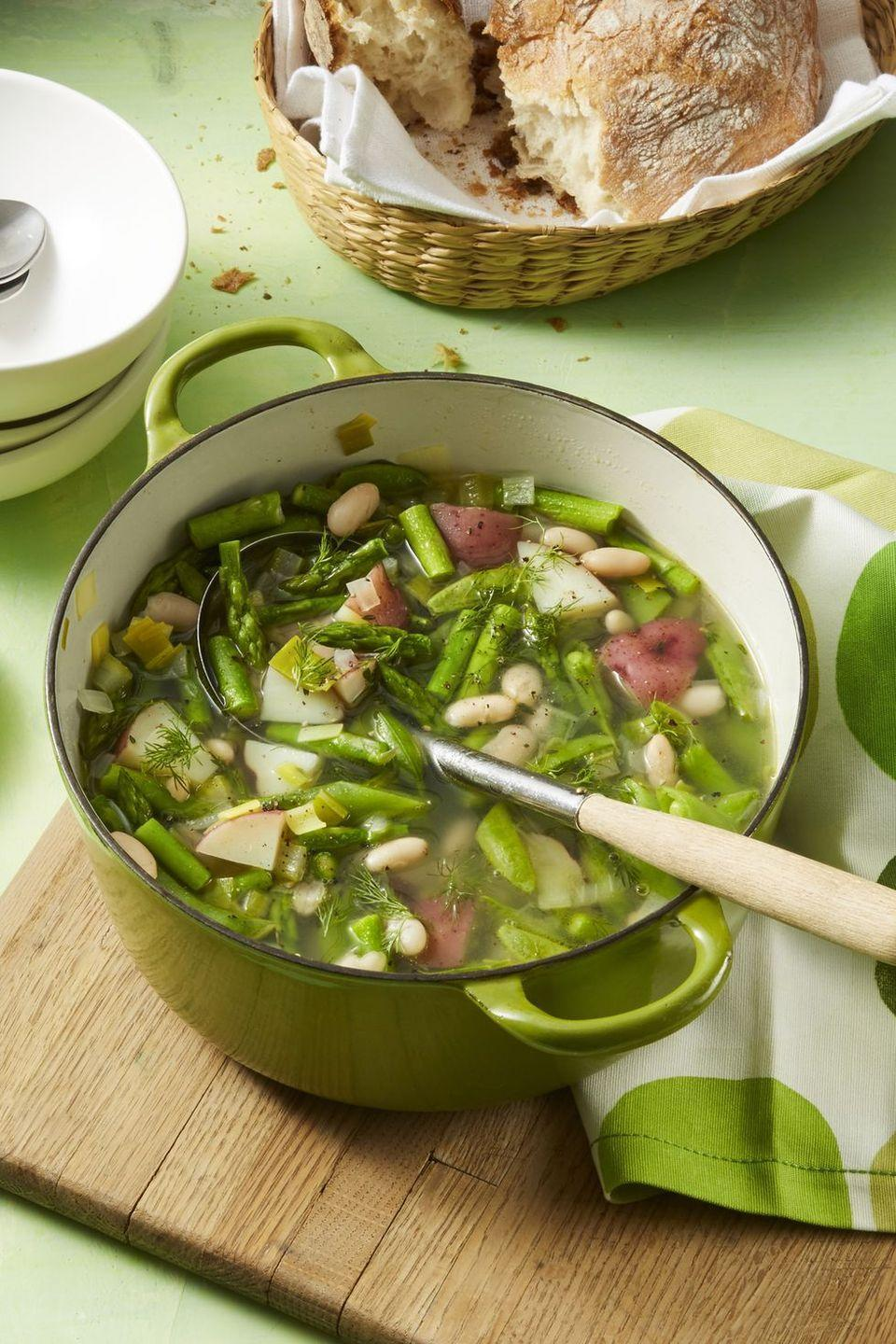 """<p>Cozy up this winter with a bowl of this easy, flavorful soup that features all of the greens you're looking for: celery, asparagus, sugar snap peas, and leeks. </p><p><a href=""""https://www.womansday.com/food-recipes/food-drinks/a19779857/spring-minestrone-soup-recipe/"""" rel=""""nofollow noopener"""" target=""""_blank"""" data-ylk=""""slk:Get the Minestrone Soup recipe."""" class=""""link rapid-noclick-resp""""><em>Get the Minestrone Soup recipe.</em></a> </p>"""