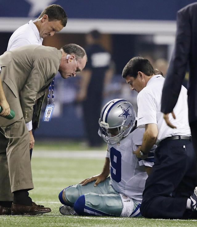 Dallas Cowboys quarterback Tony Romo (9) is helped after going down injured during the first half of an NFL football game against the New York Giants, Sunday, Sept. 8, 2013, in Arlington, Texas. (AP Photo/Tony Gutierrez)
