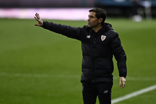Athletic Bilbao's head coach Marcelino gives instructions from the side line during Spanish Super Cup semi final soccer match between Real Madrid and Athletic Bilbao at La Rosaleda stadium in Malaga, Spain, Thursday, Jan. 14, 2021. (AP Photo/Jose Breton)
