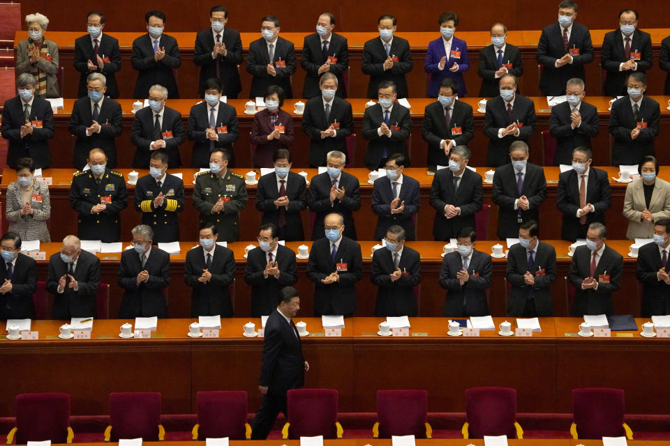 Delegates applaud as Chinese President Xi Jinping arrives for the opening session of China's National People's Congress. (AP Photo/Andy Wong)