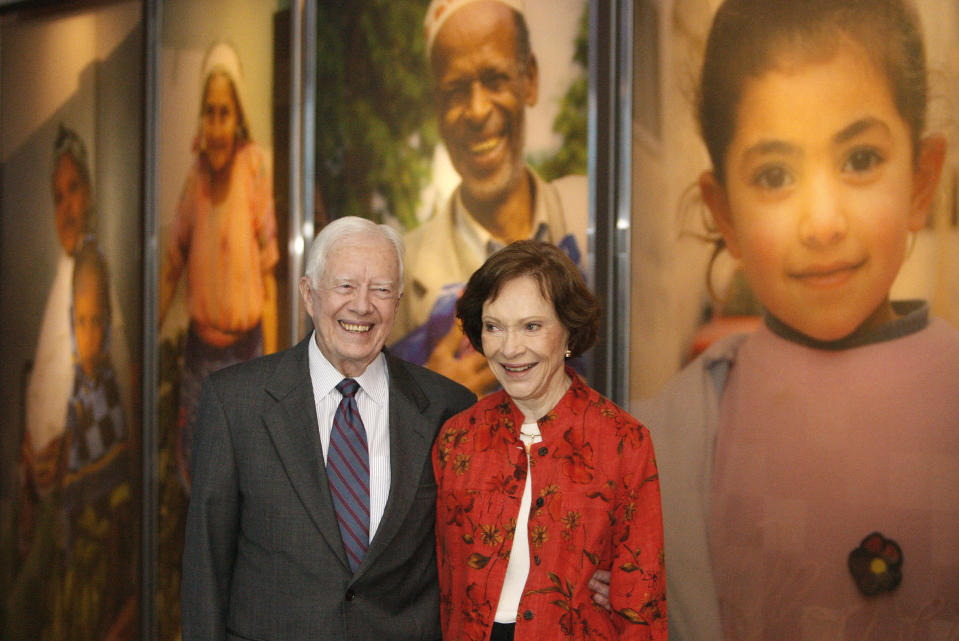 FILE - In this Sept. 28, 2009, file photo former President Jimmy Carter and his wife Rosalynn look at a new interactive exhibit at the Jimmy Carter Library and Museum in Atlanta. Jimmy Carter and his wife Rosalynn celebrate their 75th anniversary this week on Thursday, July 7, 2021. (AP Photo/John Bazemore, File)