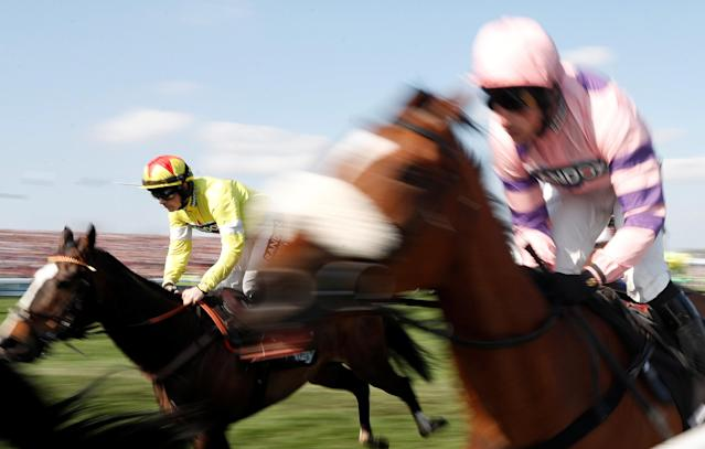 Horse Racing - Grand National Festival - Aintree Racecourse, Liverpool, Britain - April 14, 2018 Ibis Du Rheu ridden by Sam Twiston-Davies (L) in action during the 15:40 Betway Handicap Chase Action Images via Reuters/Matthew Childs