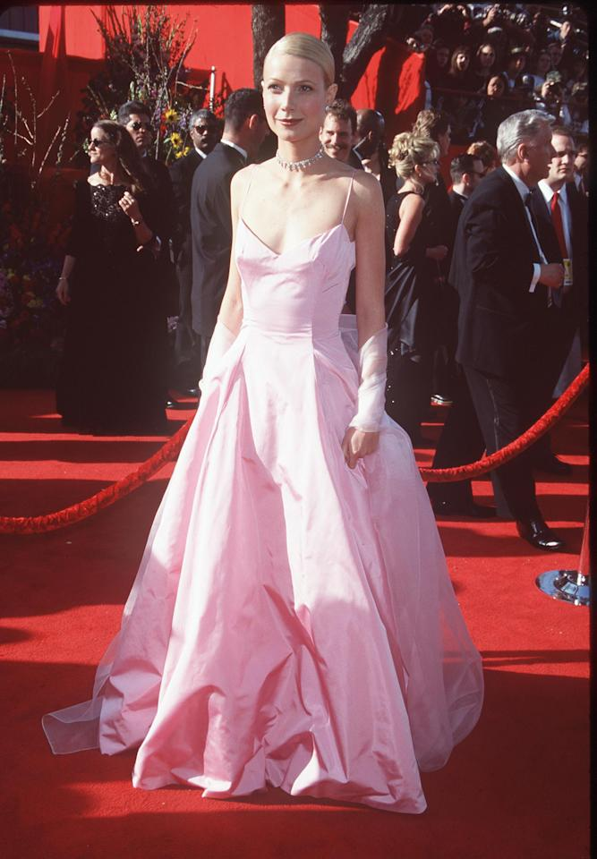 "Photo by: Getty Images<br />Gwyneth Paltrow in Ralph Lauren at the Academy Awards (1999)-<br />This pink taffeta princess dress was very atypical for red carpet attire at the time, and some critics complained that the top looked ill-fitting. We think the ""Shakespeare in Love"" best actress wore one of the prettiest Oscar dresses ever."