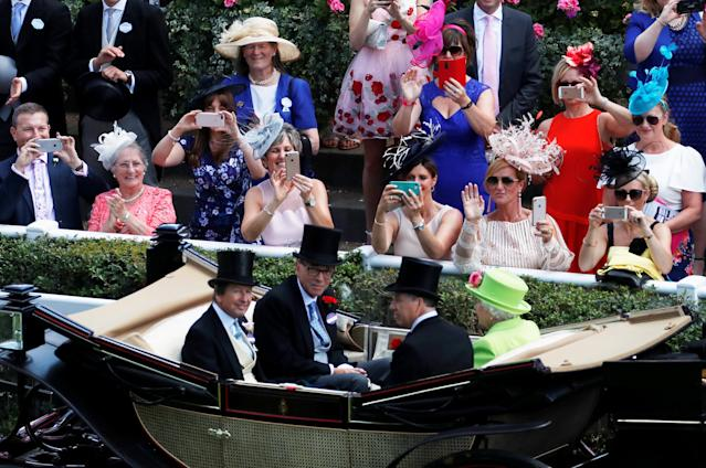 Horse Racing - Royal Ascot - Ascot Racecourse, Ascot, Britain - June 22, 2018 General view of Britain's Queen Elizabeth with racing advisor John Warren during the royal procession before the start of the racing Action Images via Reuters/Andrew Boyers